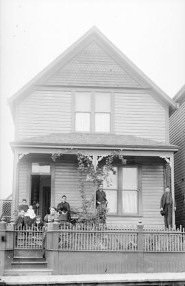 [Family seated on front steps and porch of house at 511 Barnard Street (Union Street)]
