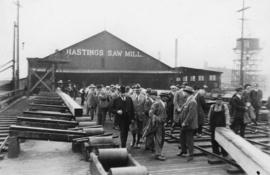 British journalists [outside Hastings Sawmill]