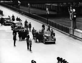[View of King George VI and Queen Elizabeth in car at C.P.R. Station]