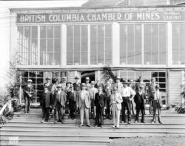 Group photograph in front of B.C. Chamber of Mines exhibit