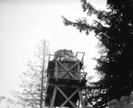 Liquor Board picnic [picnickers atop water tower, possibly Bowen Island]