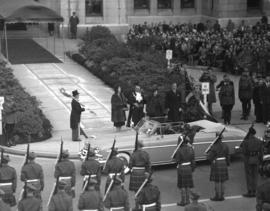 [View of H.R.H. Princess Elizabeth and H.R.H. Philip Duke of Edinburgh leaving City Hall]
