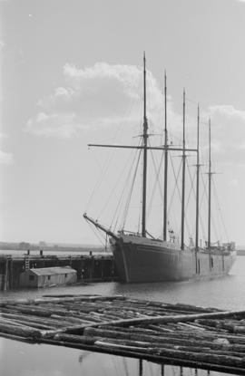 [Five-masted ship at dock]