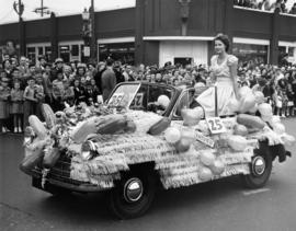 Decorated car carrying Miss Grandview beauty queen in 1949 P.N.E. Opening Day Parade