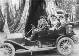 [A group in a car in front of the Hollow Tree]