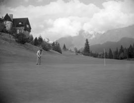 [Man taking a putt shot on the Capilano Golf Course]