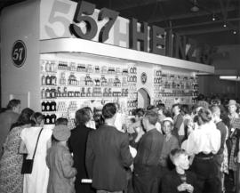 Crowd around Heinz 57 display of condiments