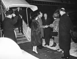 [Mrs. Rathie greets His Royal Highness Prince Philip and Her Majesty Queen Elizabeth at the airport]
