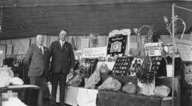 [Vancouver Exhibition - Frank E. Woodside and unidentified man at mining exhibit]