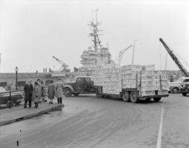 [Red Cross supplies being delivered to a naval ship]