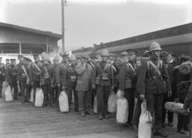 [Military - men with kit waiting to board train]