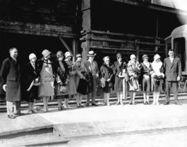 [Group portrait of Mayor L.D. Taylor with pageant contestants at C.P.R. Station]
