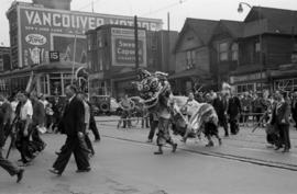 [Lion Dance in Chinese parade crossing the 400 Block East Hastings Street during VJ Day celebrati...