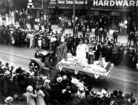 [An unidentified scale company float in the 600 Block of Granville Street during a Victoria Day p...