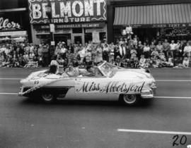 Miss Abbotsford in decorated car in 1955 P.N.E. Opening Day Parade