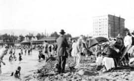 [Swimmers and watchers at English Bay]