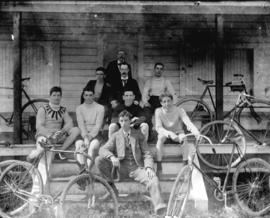 [Men with bicycles assembled on front steps of Brockton Point clubhouse]