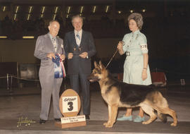 T.R. Fyfe and judge presenting group three [Herding Group: German Shepherd] award at 1973 P.N.E. ...