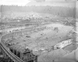 [Partially constructed Coquitlam Dam, showing headgate valve house in foreground and construction...