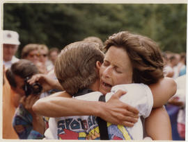 Two people hugging at marathon race