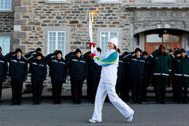 Day 39 Torchbearer 17 Sylvie Gravel carrying the flame in Nicolet, Quebec
