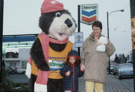 Tillicum poses with woman and child at Chevron station on 4th Avenue and Macdonald Street