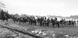 [Soldiers training on horses near camp]