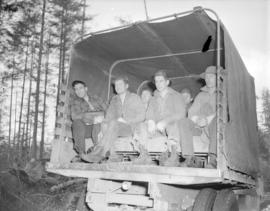 [Men sitting in the back of a truck at] Sandspit [on the] Queen Charlotte Islands
