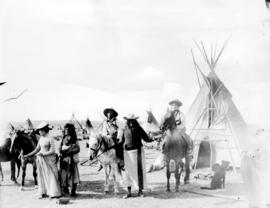 Blackfoot Sun Dance, Gleichen N.W.T., Mounted Indians, tepees and white woman