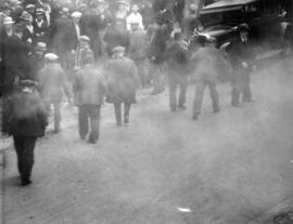 [A crowd being dispersed with tear gas during the Powell Street Riot]