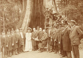 "[Lord Strathcona and Sir MacKenzie Bowell with group in front of ""Hollow Tree""]"