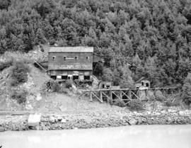 [View of old mine buildings with graffiti, near Skagway, Alaska]