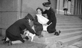 [First aid demonstration by Women's Ambulance Corps]