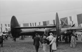"[Rear view of an American P-61 ""Black Widow"" fighter at airshow]"