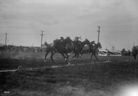 Men in uniform on horses in a competition