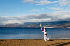 Day 88 Torchbearer 148 Jeri-Lynne Hickling crries the flame in Penticton, British Columbia