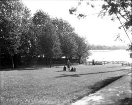 Park on Beach Avenue, facing south with children and woman