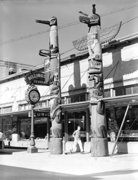 [View of totem poles in front of Billingsley Jeweler, Ketchikan, Alaska]