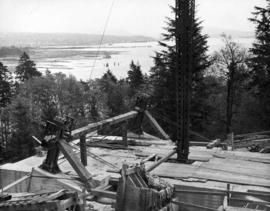 Bridge-head in Stanley Park.  Steel suspension cables will be held in position on top of the two ...