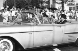 [Crowds line a road as H.R.H. Princess Margaret is accompanied in a car by Lieutenant Governor Fr...