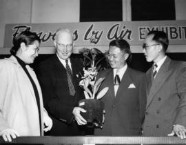 P.N.E. Vice-President J.S.C. Moffitt and Chinese representatives at Flowers by Air exhibit, 1952 ...