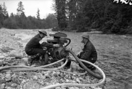 [Two A.R.P. firemen with auxiliary pump at Lynn Creek]
