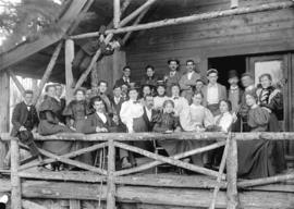 [Group of  men and women assembled on porch of Capilano Canyon Cottage]