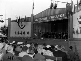 Unidentified speaker on Outdoor Theatre stage during 1955 P.N.E. Opening Ceremonies