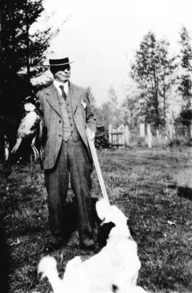 [L.D. Taylor posing with results of pheasant hunt]