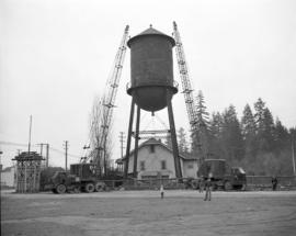 [Cranes finished manoeuvering the cap of a water tower into position]
