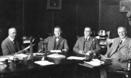 [Mayor L.D. Taylor and others at his desk]