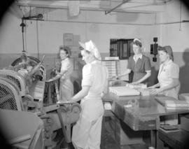 [Women packaging rolls of waxed paper at Westminster Paper]