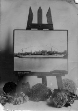 "[A photograph by Bailey Bros. showing the ""Empress of India"" at dock is propped on an e..."
