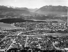 From the air [aerial view of Vancouver and False Creek showing Burrard and Granville Street bridges]